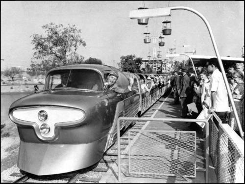 thruwaltseyes:  Walt takes his Viewliner for a spin around Tomorrowland.   ^Follow this blog for images from the years that Walt oversaw Disneyland before he passed away.