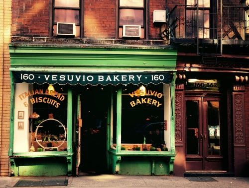 "Vesuvio Bakery, a glimpse at a New York from long ago. Soho, New York City.  This is one of my absolute favorite storefronts in Soho. A little over 90 years old, Vesuvio Bakery still looks as it did for decades.  A tiny bit about the original owners of it is found in a newspaper article from 2003 :  ""Dapolito, 83, worked as a boy in the bakery on Prince St., decades before the neighborhood came to be known as Soho. His father and mother, Nunzio and Jennie, immigrants from Naples, opened it in 1920 and Tony went on to own it after they died."" - Source  The bakery is no longer in the Dapolito family and has changed ownership several times since the article cited above was written. It is currently still operating as a bakery and the owners have kept the storefront intact.  —-  ""Soho Bakery"" Posters and Prints are available for purchase by clicking here"