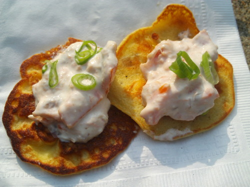 Prosciutto (i think) in some kind of cream sauce on a potato pancake, free at an art show, seriously, they serve these in heaven