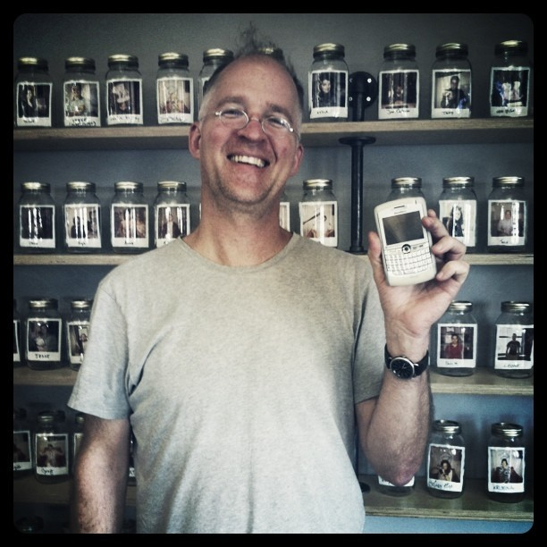 "Jerry (Veteran NoRes cameraman) in front of the shelves of zpz crew photos (in mason jars…Why? Explanation from bawse: ""all the ingredients that make up zpz"", we say shrunken heads…)"