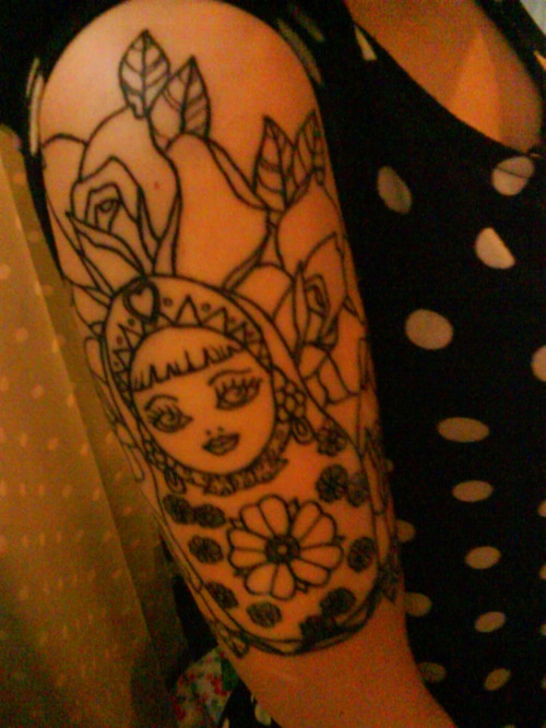 my russian doll half sleeve, still not coloured. would LOVE some suggestions on what colours to get it because i'm totally stumped! done by paul @ devil's own tattoos, leicester. i love this beauty.
