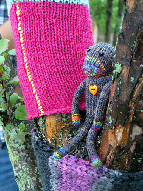 Visitor by trailerfullofpix on Flickr. Tree Cozies by Riot Prrl, Seymour the Sock Monkey by TJ Wong.