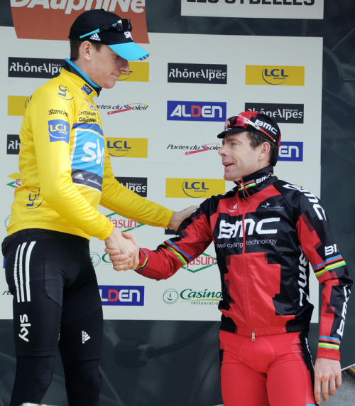 Britain's Yellow jersey of overall leader, Bradley Wiggins (L) shakes hands with second-placed Australian Cadel Evans (R) at the end of the seventh and last stage of the 63rd edition of the Dauphine Criterium cycling race run between Pontcharra and La Toussuire on June 12, 2011. Wiggins won the Criterium du Dauphine. (Photo by Pascal Pavani /AFP/Getty Images)