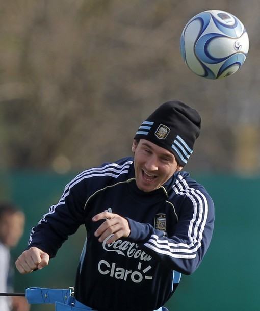 "footballandmusic:  Messi: ""On me beanie 'ead!""  What a goober. Brought to you by Coca-Cola."