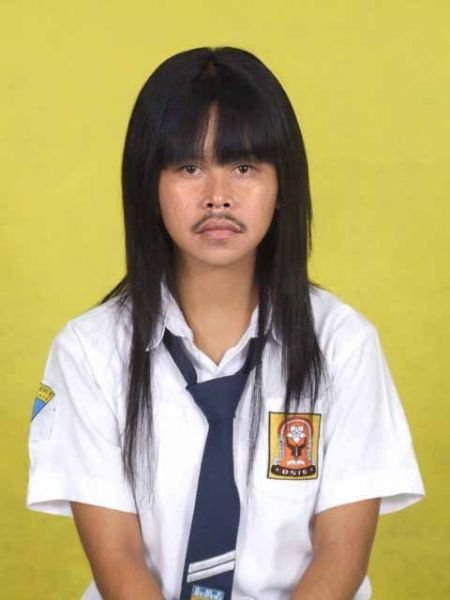 Junior high school student. I'll call it with 'it' instead of she/he. Lol