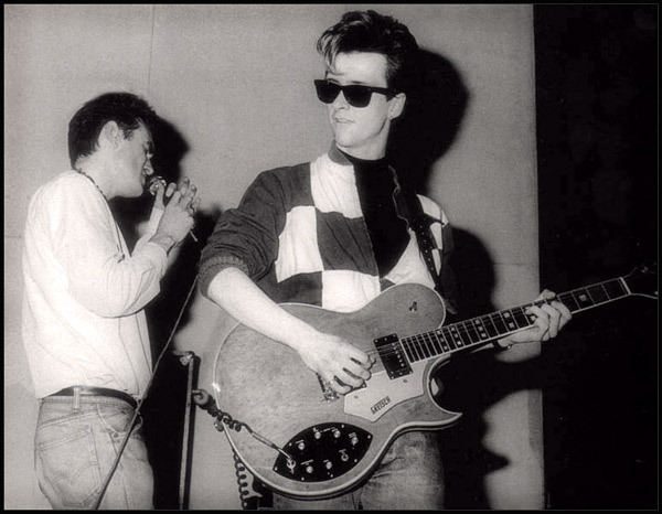 Morrissey & Johnny Marr from The Smiths live at the University of London, May 6, 1983 Photo by Paul Slattery (Reworked for the contrasts, sharpness, reframed, retouched by myself)