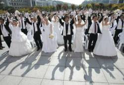 Thousands marry in a mass ceremony in China on 10/10/10 as this date was believed to be a sign of good fortune.