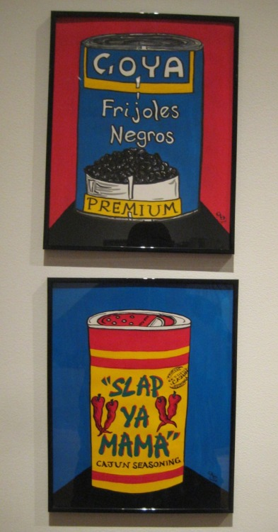 "Camille Banuchi, ""Black Beans"" and ""Slap Ya Mama"" (2009)  I tend to enjoy a straight-forward, pop aesthetic involving food. I also appreciate Reggie Michael Rodrigue's interpretation regarding identity.  thevisionarypost:  Camille Banuchi ""Black Beans"" and ""Slap Ya Mama"" gouache and calligraphy marker on paper 2009 on view in the ""Southern Open 2011"" at the Acadiana Center for the Arts in Lafayette, LA until July 9, 2011 Banuchi's drawings occupy the outer edge of a wall near the entrance to the exhibition in an area of the Southern Open 2011 I've taken to calling the UN.  It was located near Dave Greber's cultural mash-up ""Open Arms,"" and the NatGeorific photographs of Dr. Jian Hang, and the ""cathedral window/mandala"" collages of Troy Dugas. Banuchi was representing the cultures of South Louisiana and Puerto Rico with her two drawings.  One drawing is of a can of Goya black beans:  Gooo, Puerto Rico!  One is of a can of Slap Ya Mama seasoning:  Gooo, South Louisiana! These two drawings, presented as they are, end up reading as a latter-day Warhol portrait, if you know something about Banuchi: her mother is Cajun and her father is Puerto Rican.  The drawings, along with their subjects, become stand-ins for the artist herself.  The mix of products identifies the user by way of the cultural associations they engender. This is what saves them from being simply kitsch.  What may come across as being homespun and naive, ends up saying something about the artist, and, by extension, ourselves.  The infiltration of ""products"" and the ""commercial"" in our lives has gotten to the point where these things have begun to speak for or stand-in for ourselves. For instance, a ""portrait"" of myself would have to include a pack of Pal-Mal menthol shorts, CC's Coffee, a bottle of Canadian Mist, a pound of cheddar cheese, Facebook, and Tumblr,  Yes!  It's sad but true. Art criticism is that glamorous … and healthy! Anyway, Banuchi had a nice moment in the show - something diminutive, unassuming, yet thought-provoking to it's core. - Reggie Michael Rodrigue"