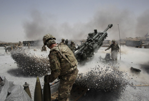 Whoa! nationalpost:  Photos of the dayU.S. Army soldiers from the 2nd Platoon, B battery 2-8 field artillery, fire a howitzer artillery piece at Seprwan Ghar forward fire base in Panjwai district, Kandahar province, southern Afghanistan, June 12, 2011. (Baz Ratner/Reuters)