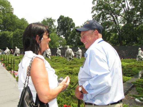 Korea War veteran Merlyn Lewis of Litchfield, right, shares a story Thursday afternoon with his daughter Michelle Stover of Kearney while visiting the Korean War Memorial in Washington, D.C., as part of the Buffalo County Hero Flight