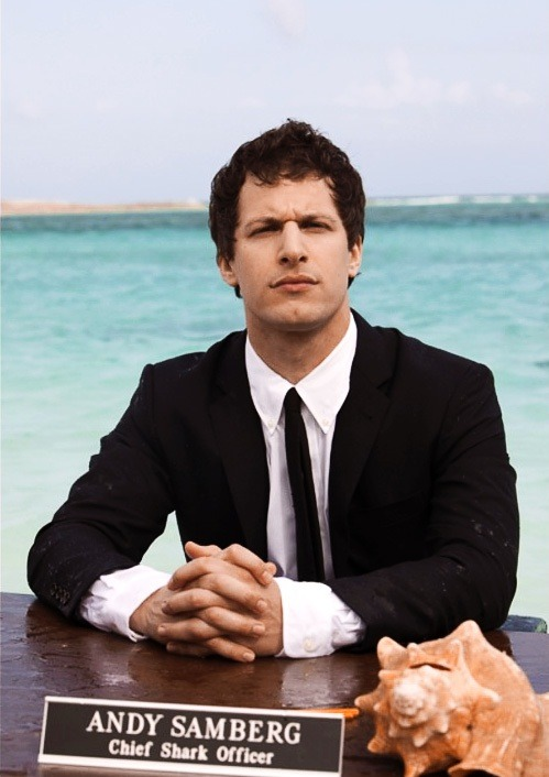 "Andy Samberg is living every week like it's… well, you know. He has the honor of serving as host — or Chief Shark Officer — for Discovery's 24th annual Shark Week, which kicks off July 31. This week's issue of Entertainment Weekly also has a first look at Samberg swimming with Caribbean reef sharks for a special airing Aug. 4, Shark City. ""They were definitely dumping tons of bloody meat into the water all around me,"" the comedian told EW. ""I knew that they needed to do it to get the sharks over there, but there's also a part of me that was like, have you guys heard of Photoshop?"""
