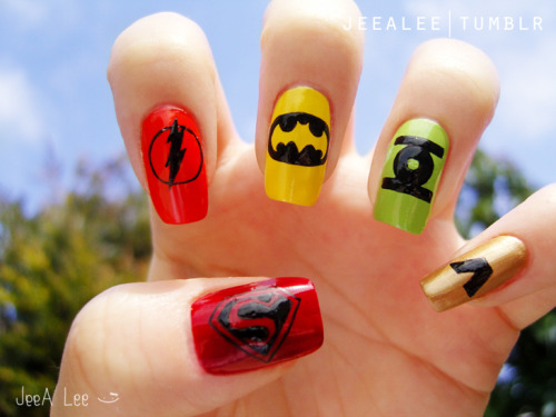 Manicure Monday: DC Comics Superheroes Nails, by Jeea Lee. Holy moly, these are amazing - the little painted emblems look like nail decals!