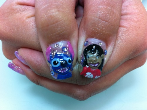 My new nails!!!! Lilo and Stitch :D Lilo kinda has a piggy nose going on, but my nail artist still did a bomb job! <3