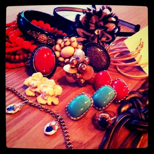 My Accessories… I LOVE accessories and could easily come home with something new every day. Here is a snapshot of just a few of my smaller, favourite accessories and where they came from…Left to right – headband (Etsy.com), black & gold bangle (Forever 21), orange beaded bracelets (Aldo), white flower ring (Forever 21), orange oval ring (Forever 21), grey oval ring (Forever 21), gold bubble ring (Bitter Sweet), white flower earrings (Joe Fresh), fish charm bracelet (antique from my mother), hoop earrings (Joe Fresh), coral and sky blue earrings (Aldo), green & gold ring (antique from my grandmother), gold knotted bracelet (gift from my hubby via Town Shoes)