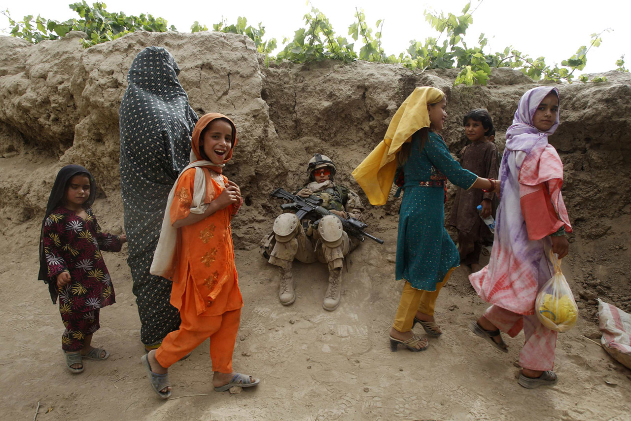 "Photos of the dayAfghan girls walk past a female Canadian soldier from 6th Platoon, Bulldog Company, 1st Battalion, 22nd Royal Regiment as she rests  during a patrol in the Panjwai district of Kandahar province southern Afghanistan, June 13, 2011. Canada will end its combat role in Afghanistan by the end of July, after nearly ten years fighting in Afghanistan. (Baz Ratner/Reuters)Canada left Taliban 'on its knees': Afghan commanderCanada's efforts have left the insurgency in southern Afghanistan ""on its knees,"" says the commander of the Afghan troops who have been fighting alongside Canadian soldiers.""It is a matter of fact that the Canadians sacrificed a lot here,"" said Brig.-Gen. Ahmed Habibi. ""I remember there were 400 or 500 Taliban in the area when the Canadians came to Kandahar in 2006. They are the ones who stood with us and fought not only in Panjwaii but across the province. The enemy is on its knees here now. The truth of it is that it is because of the hard work of the Canadians."""