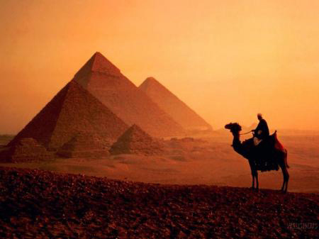 The pyramids of Giza, Egypt, at dusk (via Travel Guides: The Great Pyramid Of Giza)