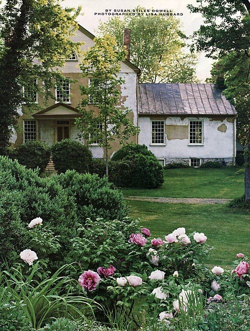 Roses bloom in this lovely garden in the grounds of a crumbling country house.