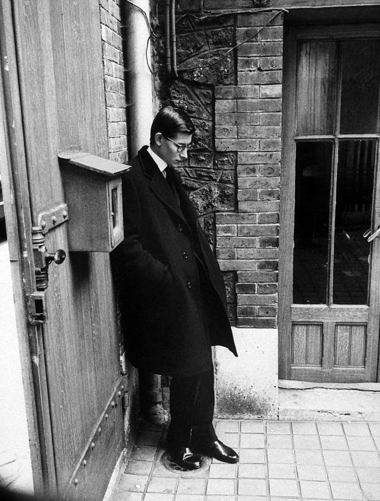 theconstantbuzz:  Yves Saint Laurent standing alone after attending Christian Dior's funeral © Loomis Dean, Paris, Oct. 1957.