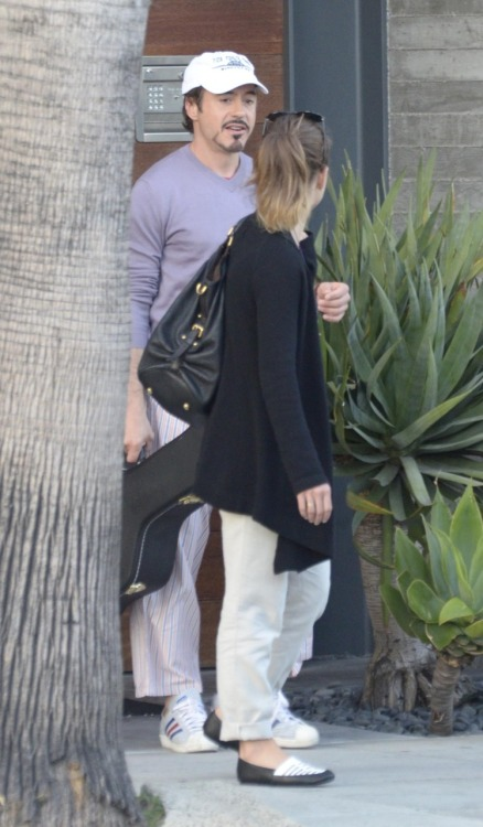 robertandlittled:  Robert Downey Jr and his missus Susan leave their house in Malibu 6/14/11