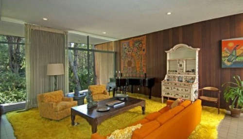 The 5 bed, 4.5 bath, vintage 1961 home was built by architect Robert  Skinner. Original details and the decor make this home an homage to  groovier times, when homes featured courtyard entries, walls of glass,  step down living rooms, and yes, wood paneling.