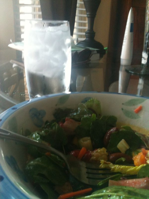 Trying to keep cool with a fresh fruit and bean salad and ice cold water brought to you by my wonderful mother!:)