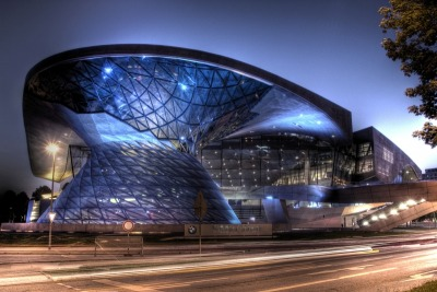 BMW Welt (English – BMW World), is a multi-functional customer experience and exhibition facility of the BMW AG, located in Munich, Germany. In direct proximity to the BMW Headquarters and the Olympiapark, it is designed to present the current products of BMW, be a distribution center for BMW cars, and offer an event forum and a conference center.