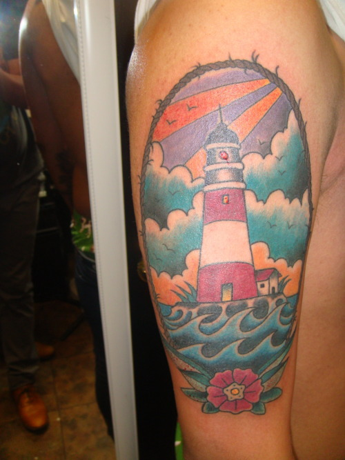 i am really starting to dig lighthouse tattoos.