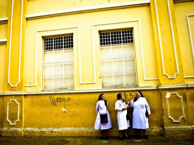 ocuca:  While exploring Cartagena, Colombia's Central District, this scene was caught outside one of the colorful city's parochial schools.