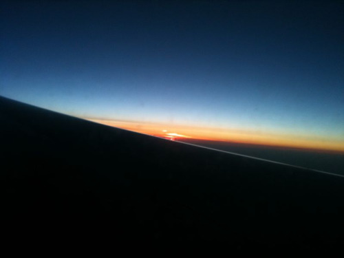 sunrise out the plane window was gorgeous… the photo doesn't come close to capturing it!