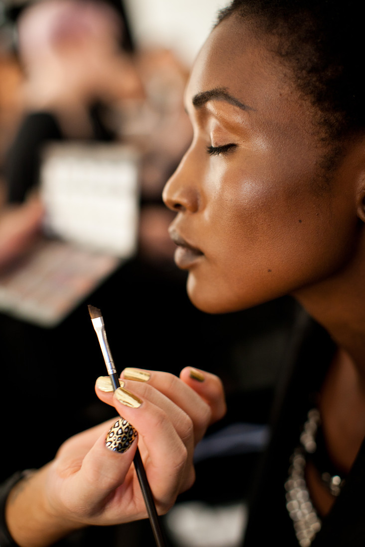 A model gets her make up done backstage at Rosemount Australian Fashion Week 2011. More photos here.