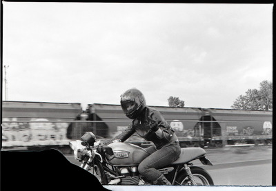 """UP YOURS!"" Attitudinal motion shot of me on the Thruxton by Giles Clement. (More from this series.)"