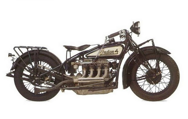 jessepascarella:  1930 Indian 403 A 1930's ultimate touring machine, Indian Fours were produced from 1927-1942. Smooth and powerful, these machines could be used at 70 m.p.h. for hours. The Art Deco era hits the Indians adorned in a full range of Duco colors, two-tone designs, pinstriping, and decals. Photographer unknown