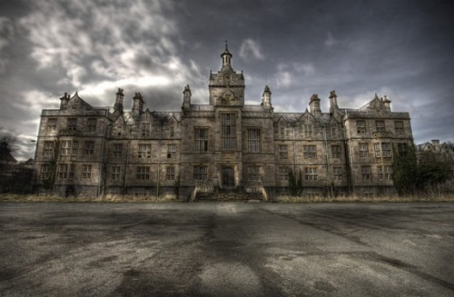 Denbigh Asylum- Wales, UKDenbigh Asylum was constructed in 1844 in response to the terrible neglect Welsh patients were facing in English prisons in the 1800s. Since Wales didn't have the funds to build their own asylums, their sickest patients had to be sent to asylums in the greater UK. Although they received similar treatment to the other English patients, most Welsh patients didn't speak a word of English, and their doctors in turn spoke no Welsh.Clearly, something had to be done and money was set aside to build Wales its own asylum where patients could receive proper care. After Denbigh was completed it housed 1,500 patients and 1,000 staff Although it was in use for years, the arrival of mental health reform in the '60s meant the end for Denbigh, and it was closed in sections from 1991 to 2002. Since 2002 the buildings have stood empty, but the asylum still had one important visitor in the last few years; the Prince of Wales visited in 2004, granting the buildings historic status and saved them from destruction. Although some asbestos removal has started, not much has changed since 2004. Plans to turn Denbigh into a housing development have been approved, and construction could begin any day.