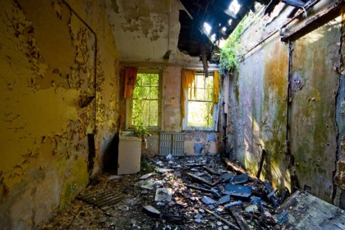 "Hellingly Asylum- East Sussex, EnglandThe Hellingly Asylum in East Sussex wasn't just a home for mentally ill, it was like a little city. Located deep in the country, the asylum was designed by famed asylum architect George Thomas Hine to be so remote that the stresses of the outside world couldn't harm the hospital's delicate patients. Hellingly had its own railway station and tracks that brought coal – and later people – into the compound. It also had its own farmland, water tower, morgue, dentist office, hair salon, and clothing store to supply both the patients and staff with basic necessities. It also had a special wing for ""mentally defective"" children as well as ""advanced treatment"" wings where electroshock therapy was practiced. Given its massive size and primitive treatment methods, Hellingly was shut down in 1994. Having stood abandoned for so long, the damage to Hellingly is incredibly severe. The victim of countless arson attacks, much of the hospital was torched and charred by the time it was set for demolition in 2010. Reportedly, there isn't much left to Hemminly as of February 2011"