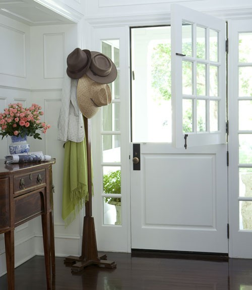 From House Beautiful. I love a Dutch door!