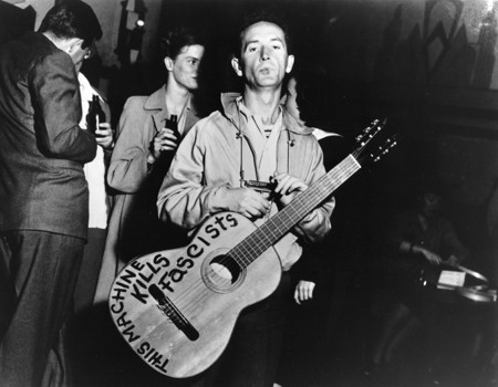 Photograph by Lester Balog - Woody Guthrie (This machine kills fascists, 1943)