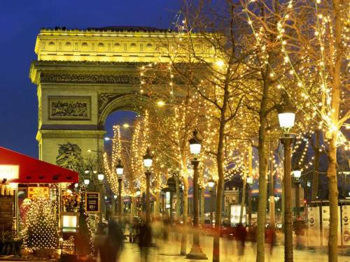Fairy lights sparkle along the Champs Elysees, Paris