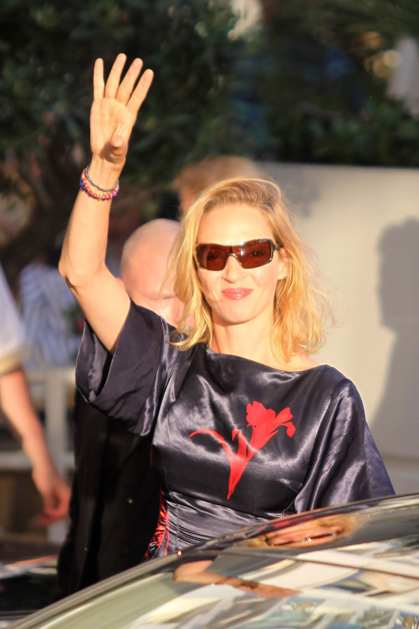 Uma Thurman arriving for Cannes Film Festival wearing silk Louis Vuitton