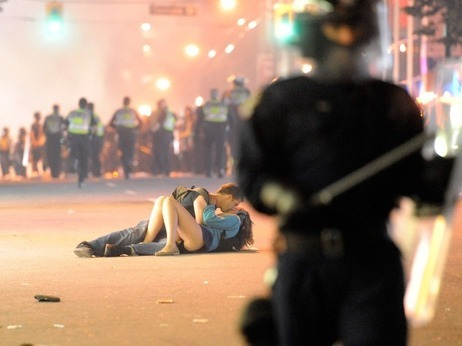 "Yes, Those People Are Literally Kissing, On The Ground, In The Street, Amid A Riot by Claire O'Neill Some burn couches, others loot from store windows. But, when hockey-induced havoc fills the streets of Vancouver, some people take that opportunity to just flat-out make-out. Seriously, this is real: ""I'm not sure what exactly was going on,"" photographer Rich Lam confesses on the phone. ""I just saw these two people and I thought they were hurt … I didn't really know what I got until the editor pointed it out."" Hopefully the people in the photo will come forth and explain what, exactly, was going through their heads. Is this the V-J day in Times Square of our generation?"