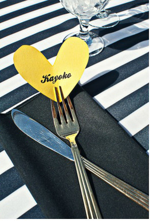 DIY Heart Table Card Such a new and cute way to display table cards for your guests. For this all you will need is some paper and good penmanship for the names. I would suggest folding the paper in half to get a symmetrical heart.  Enjoy and Happy Planning. <3