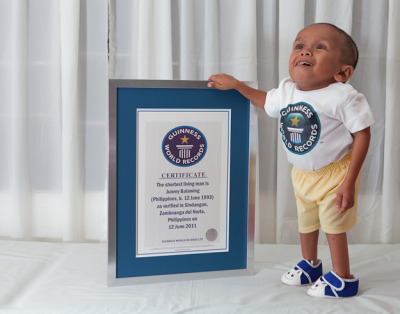 pinoytumblr:  Guinness names Filipino as world's shortest man A poor Filipino blacksmith's son who stands less than two feet (60 centimeters) tall was declared the world's shortest man by Guinness World Records on his 18th birthday last June 12, sparking a celebration in his far-flung hometown. The title was bestowed on Junrey Balawing in Sindangan in the southern Philippines, with Balawing's parents, villagers and officials showering the coastal town's newly famous resident with a feast, a cake, balloons and cash gifts. Balawing measured 23.5 inches (60 centimeters) during the ceremony attended by about 100 villagers and journalists. Guinness World Records representative Craig Glenday presented Balawing with official recognition of his status as the shortest adult man in the world. Read more here