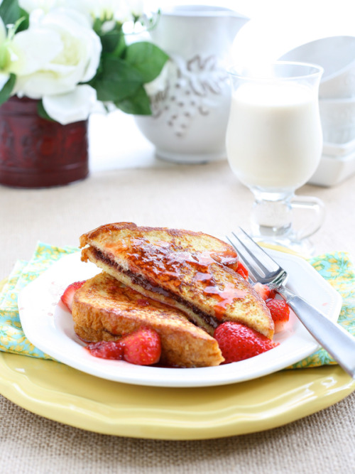 gastrogirl:  nutella stuffed french toast with maple strawberry syrup.