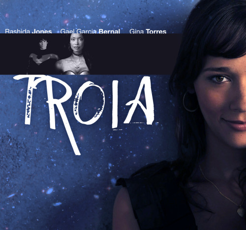 "[Image description: A poster created for a fake movie titled 'Troia'. In the foreground is a smiling Rashida Jones, who plays Donna Troy. Behind her is a black horizontal strip on a blue textured background containing small, black and white images of Gael García Bernal (as Nightwing) and Gina Torres (as Wonder Woman). Above this strip are the names of all three actors. Below it, in large white letters, is the name TROIA.]  khaleesi:  TROIAStarring Rashida Jones, Gina Torres, and Gael Garcia BernalSong: ""Sweet Talk"" by The Killers   In a world torn apart by war and social regression, there seems to be no more room for heroes. The Justice League has been torn apart by internal strife and no one, not even Wonder Woman herself (Torres), has been able to stem the growing tide of strife. Renouncing her superhero ways after growing suspicion from the public, Wonder Woman adopts her Diana Prince persona permanently.   But Diana's younger sister, Donna (Jones), has other ideas. With the help of best friend Dick Grayson (Bernal), Donna creates a new crime-fighting force to take up the cause and destroy the evil that has infected the world."