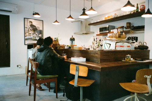(I know this is a cafe, but I really wish this was my kitchen. Truffaut poster and all!)