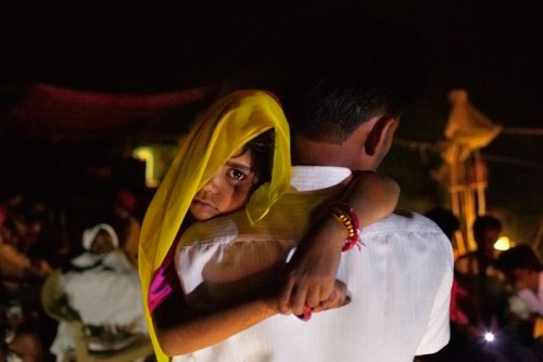 "pulitzercenter:  Long after midnight, five-year-old Rajani is roused from sleep and carried by her uncle to her wedding. Every year, throughout the world, millions  of young girls are forced into marriage. This traditional practice spans  continents, language, religion and caste. More from our latest project, the culmination of an eight-year investigation: ""Too Young to Wed: The Secret World of Child Marriage"" Image by Stephanie Sinclair."
