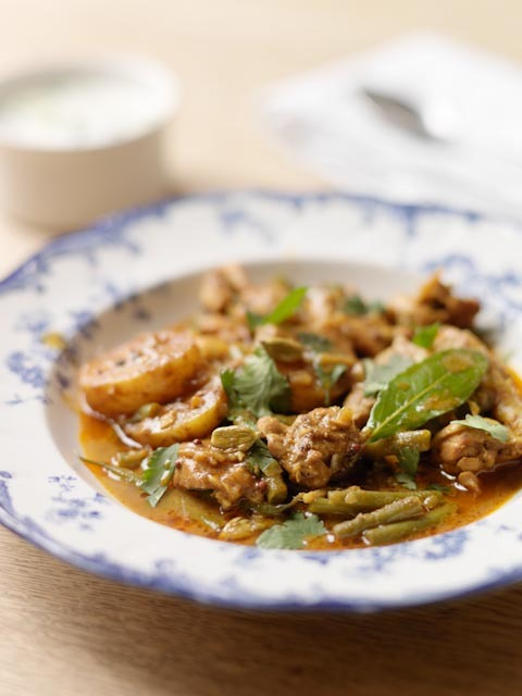 simply-recipes:  Chicken curry with green beans and potatoes  Valentine Warner – created for WWF   Serves 4      Ingredients:    4 small chicken thighs, off the bone. ( keep the leg bones for stock or soup)  2 tbsp natural yoghurt  1 ½ tbsp butter  1 medium red onion finely diced  1 small thumb fresh ginger finely chopped  1 large clove of garlic finely chopped  1tsp black mustard seeds  ½ tsp fennel seeds  1 tsp Garam Masala powder  1 tsp turmeric  1tsp cayenne pepper  1tbsp tomato puree  10 cardamom pods, broken  275g french beans, topped not tailed, and cut in three  350g new potatoes, washed and cut in four  300ml water  1 bay leaf    Chop each chicken thigh into 6 pieces and mix in a bowl with the yoghurt, garam masala, turmeric and cayenne pepper  In a wok or steep sided frying pan, dry fry the mustard seeds over a medium high heat until they begin to pop.    Add the fennel seeds and the butter. Throw in the onions and cook them for a couple of minutes until they begin to brown. Add the ginger, garlic and bay leaf and fry for a further 30 seconds Add the chicken with its yoghurt the cardamom seeds and their broken pods. The chicken should sizzle immediately on entering the pan. Fry hard for 6 minutes or so stirring every now and then until coloured.   Stir in the tomato puree and add the water and salt. Follow up with the potatoes and beans then turn down the heat and gently simmer all together for 20 minutes or until the potatoes have cooked and thickened the sauce.    Serve with cucumber mixed with a little more yoghurt and some chopped mint.  ound 5 minutes. Serve immediately.