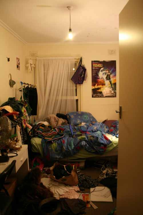 A peak into my bedroom. My habitat. My cave. My den. My dungeon. My seclusion hut. My sanity and my insanity. This is me. I'm sorry for the disappointment. Garry bought me a 'Back to the Future' poster to tizzy my wall. It arrived yesterday. It pleasures me.