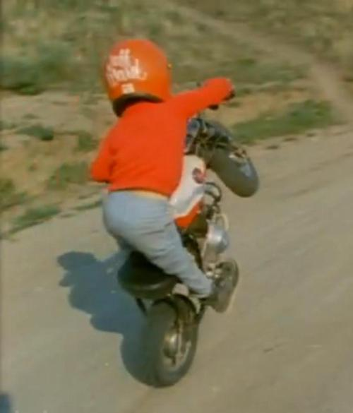 "start em young windblast:   ""Did you know that the wheelie kid from On Any Sunday is actually AMA motorcross/supermoto Champion Jeff Ward?""  I heard this a long while back, but I didn't know whether to believe it or not, but now that I have the screencap you can clearly see that his name is written on the back of his helmet! Right on! That solves that. Jeff Ward is one of my favourite all-time racers for sure, even more now than in his heyday. Most racers lose their edge with age, but it's really fun to watch Jeff enter a race in something as physical as supermoto and absolutely spank extremely talented racers half his age (he's 50 on the 22nd of this Month!). Click here to see him dominate at the X-Games in 2006. [screencap via Motorcycho]"
