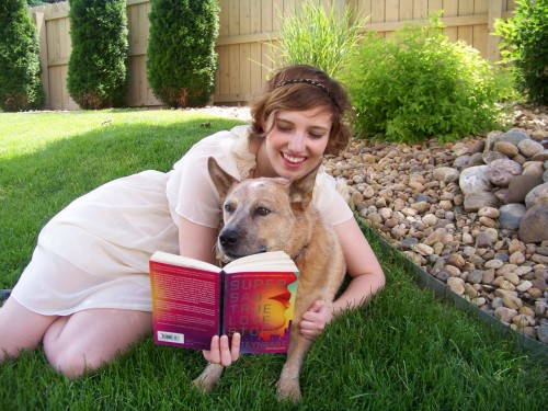 seymoursfatlady:  Jill and Sydney reading Super Sad True Love Story :)  Awwwwwww! (Read about the Super Happy Bookloving Dogs Contest here.)