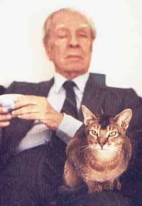 Borges and his kitty; the kitty sees for him.